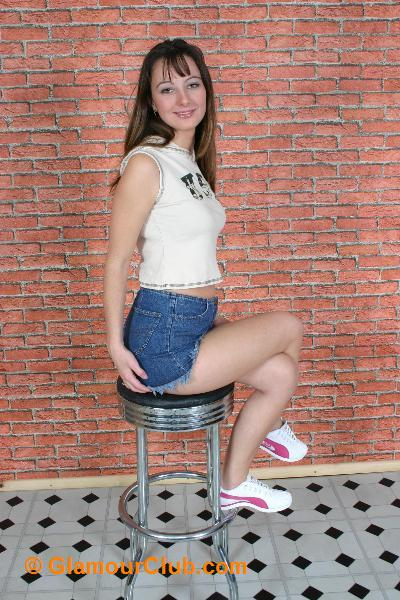 Honey B denim shorts and crop top sitting on stool