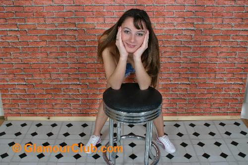Honey B leaning over stool