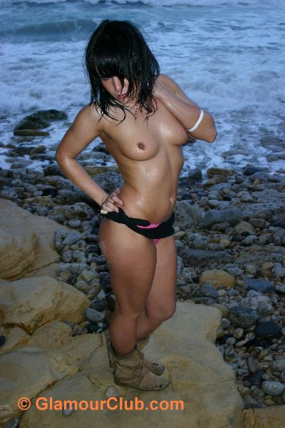Jaki Leigh topless standing on rock