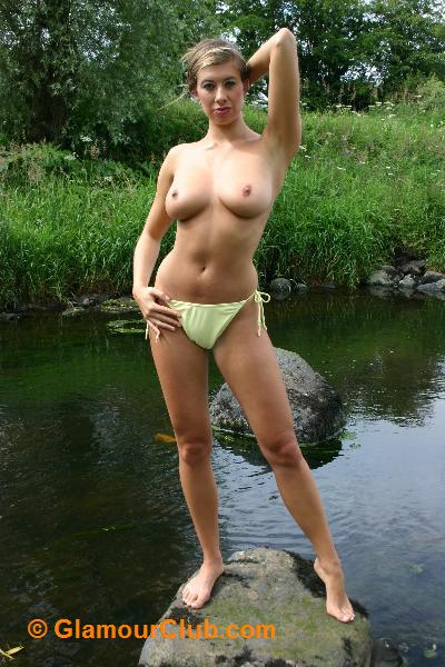 Maria Eriksson topless standing on rocks