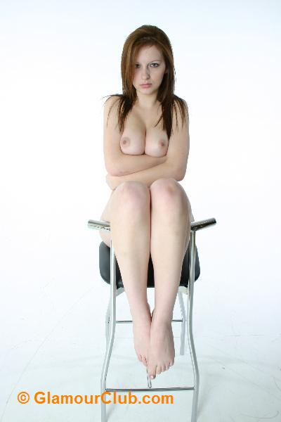 Morgan topless sitting on stool