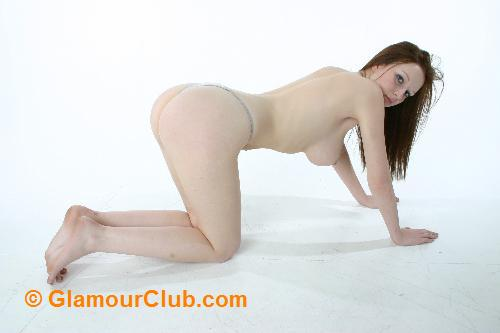 Morgan topless on all fours