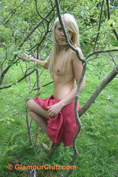 Oksana G topless among the branches