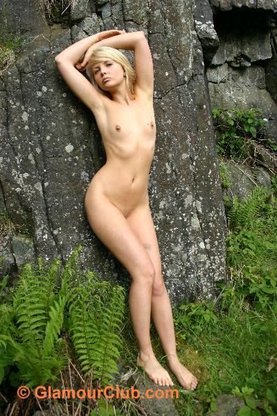 Oksana G naked against rocks