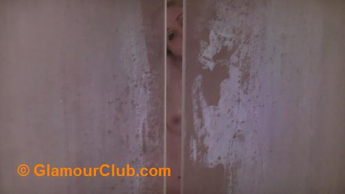 Spying on Rachelle Summers through gap in the shower doors