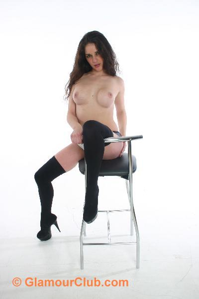 Rebecca Bailey topless with knee over stool