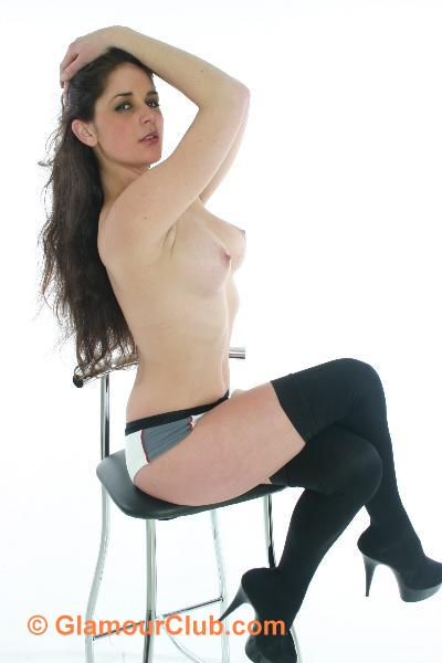 Rebecca Bailey topless sitting on stool