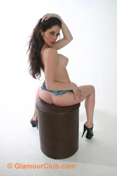 Rebecca Bailey denim skirt on stool showing bum
