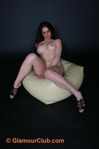 Rebecca Bailey naked sitting on pouffe