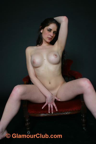 Rebecca Bailey naked on chair with legs spread