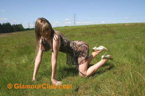 Sarah Blue on all fours in summer dress