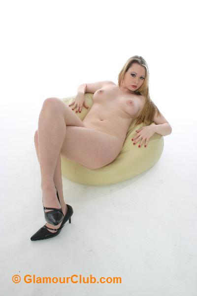 Shona naked lying on pouffe