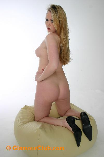 Shona naked kneeling on pouffe bum shot