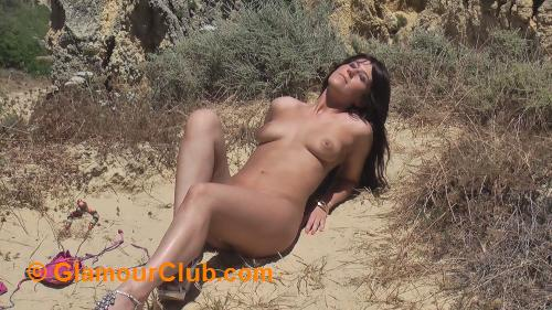Jaqi naked on clifftop