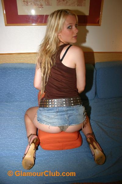 Lisa Littleton straddling cushions with denim skirt riding up to show her knicker clad bum