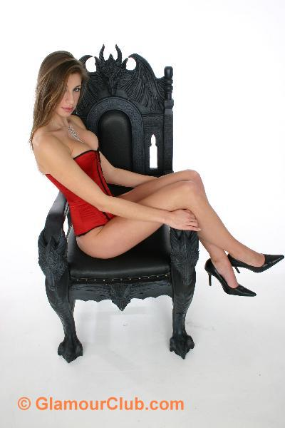 Maria Eriksson sitting sideways on chair