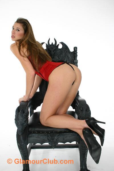 Maria Eriksson kneeling on chair showing off her bum
