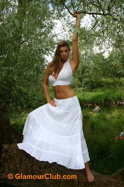 Maria Eriksson in white skirt and bra top