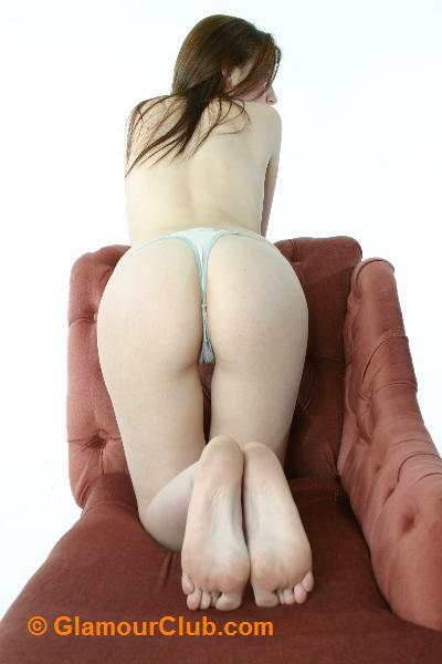 Morgan bum shot leaning over couch
