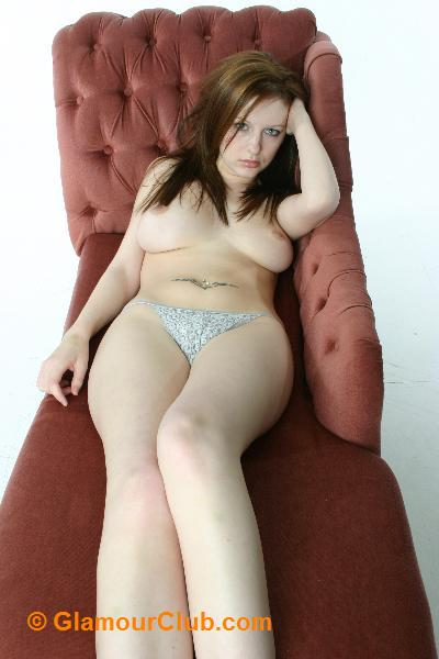 Morgan topless lying on couch
