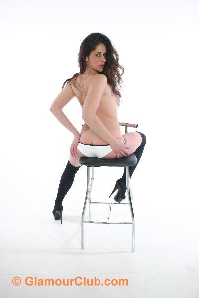 Rebecca Bailey straddling stool pulling knickers down to show bum