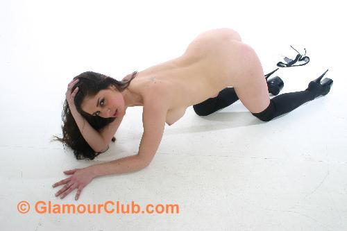 Rebecca Bailey naked on all fours in black stockings and heels