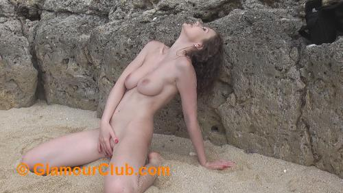 Tina Kay naked in the sand covering her pussy with hand